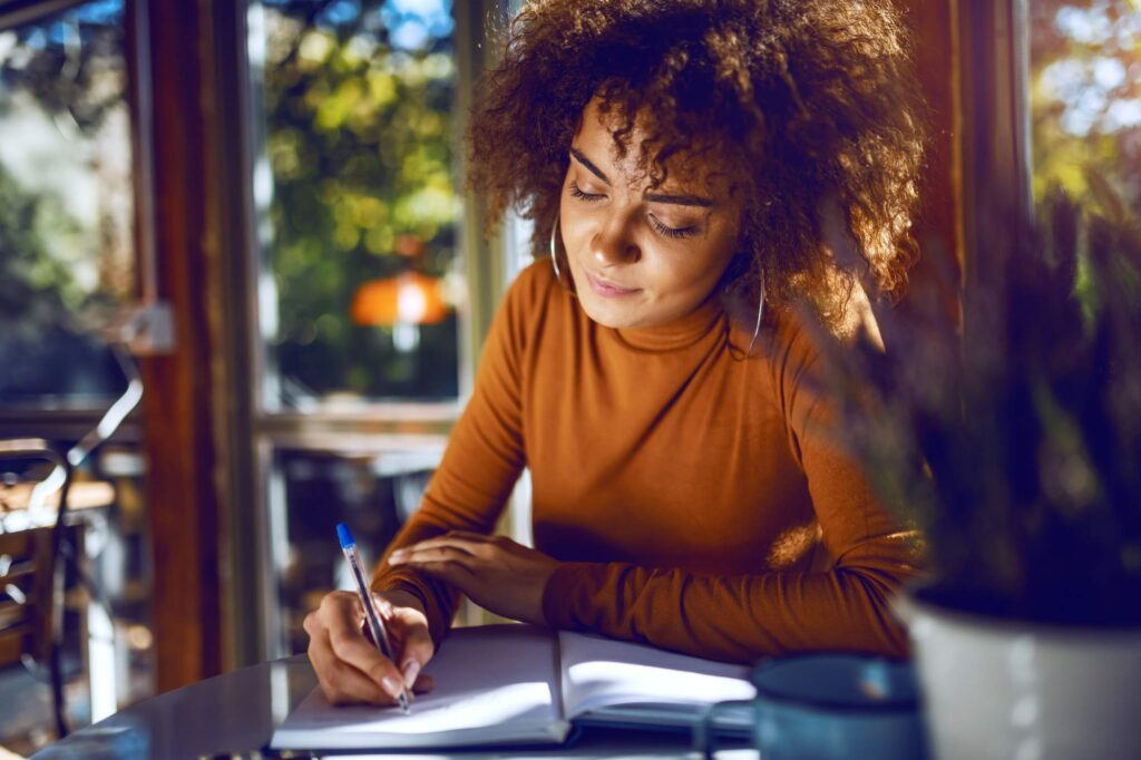 Young professional woman writing a business plan