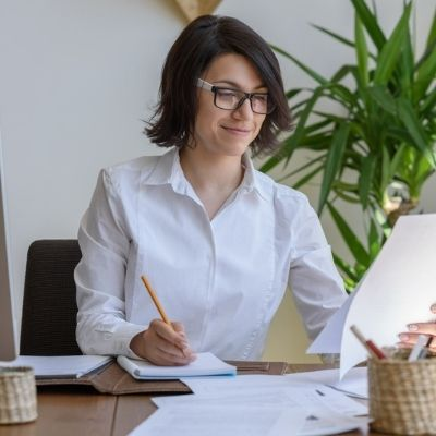 smiling businesswoman working on goal setting