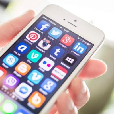 A smartphone screen with multiple social media icons