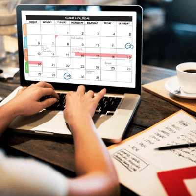 businesswoman working on calendar on laptop