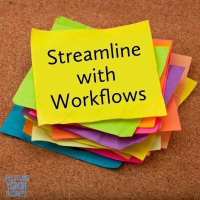 """stack of colored post-it notes with """"streamline with workflows"""" printed on top note"""