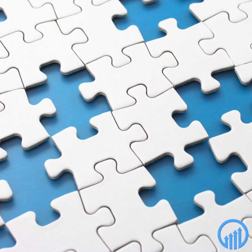 white puzzle pieces partially assembled on a blue background